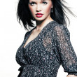 Beautiful girl with perfect skin in a dark dress with black short hair and — Stock Photo