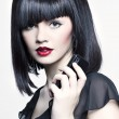 Beautiful girl with perfect skin, red lipstick and black hair with telephon — Stock Photo