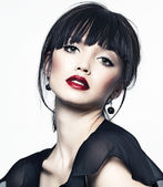 Beautiful girl with perfect skin, red lipstick and black hair on white back — Stock Photo