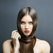 Beautiful girl with perfect skin, red lipstick and long, smooth hair — Stock Photo