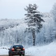 Car on winter road — Stock Photo