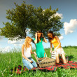 Girlfriends on picnic — Stock Photo