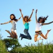 Stock Photo: Girlfriends jump