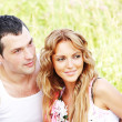 Lovers on grass field - Stock Photo