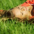 Woman on green grass - Stock Photo