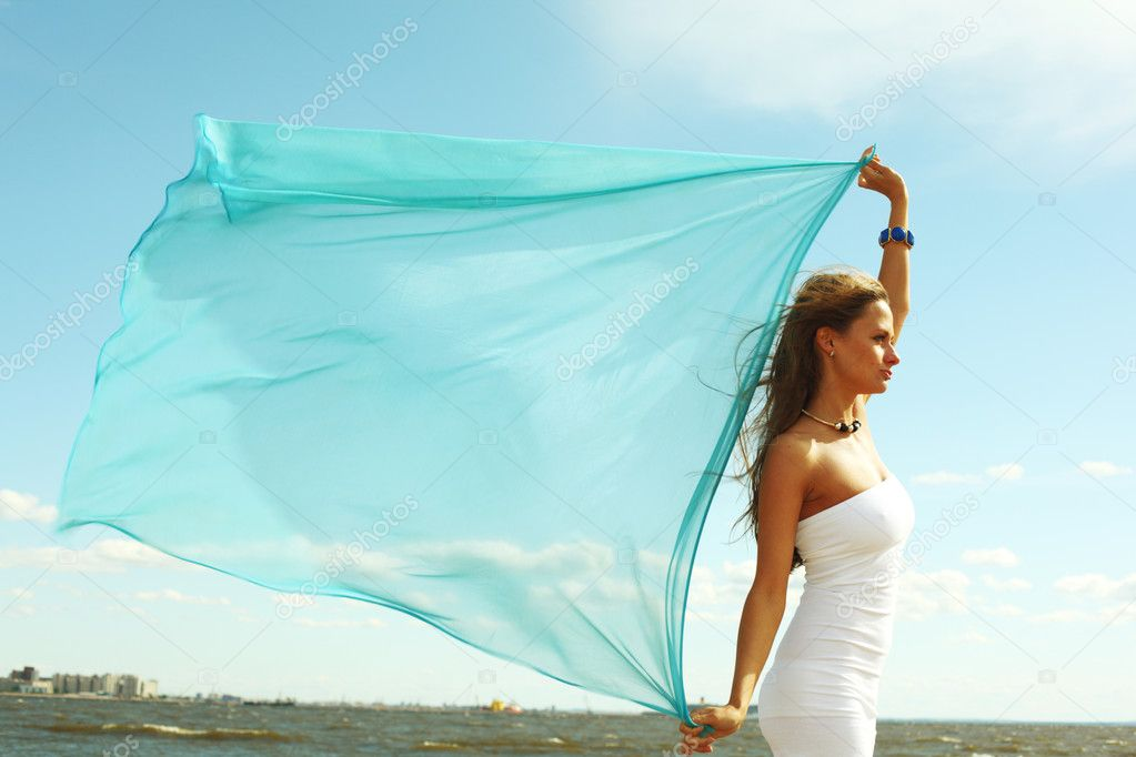 Woman fly in the blue sky by fabric — Stock Photo #6752954