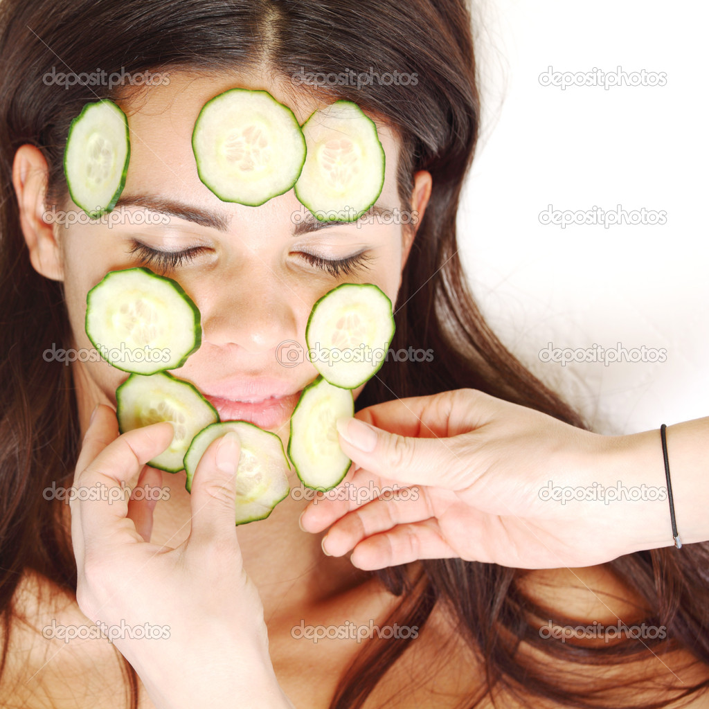 Cucumbers circles on a girl face — Stock Photo #6753115