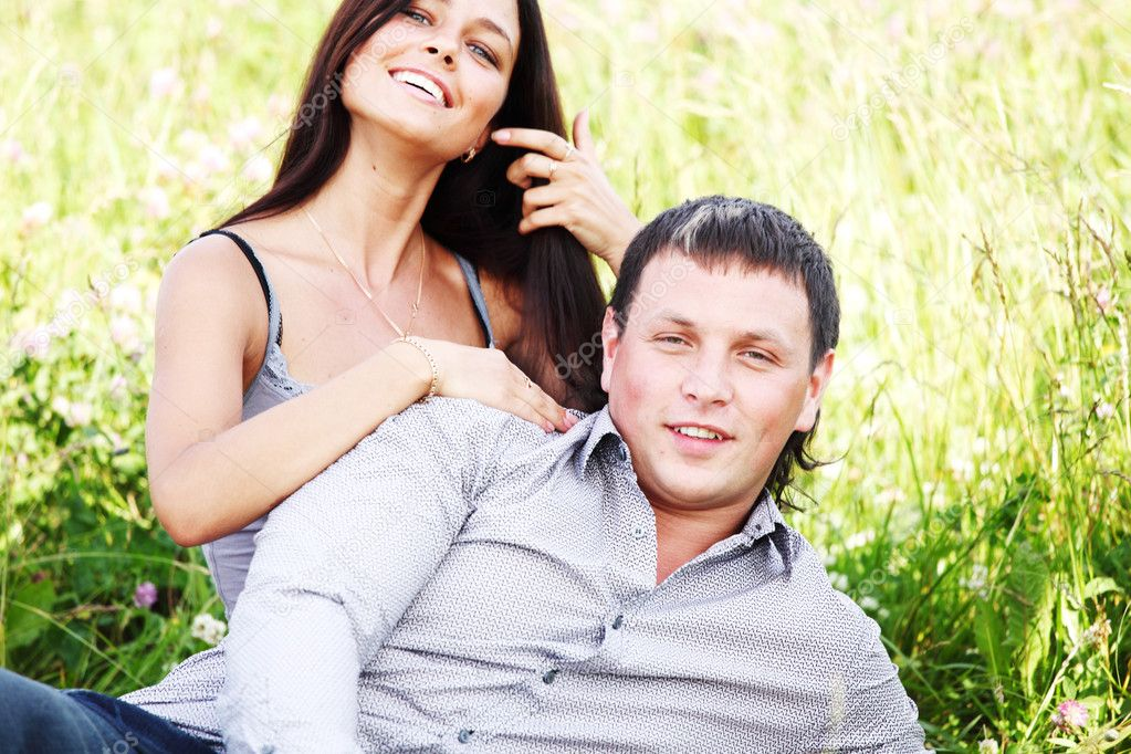 Two lovers on grass field — Stock Photo #6753717