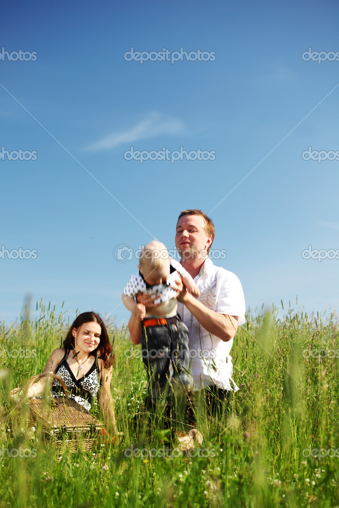 Happy family in green grass  Stock Photo #6836193