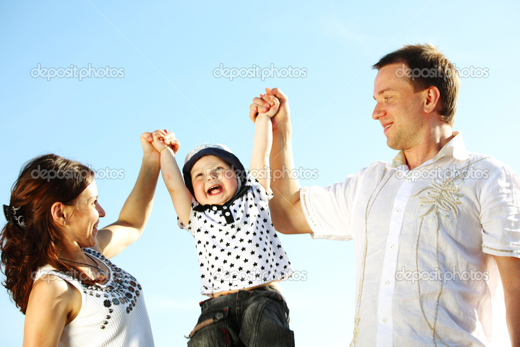 Happy family blue sky on background — Stock Photo #6838778
