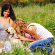 Girlfriends and dog — Stock Photo #6848464