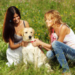 Girlfriends and dog — Stock Photo