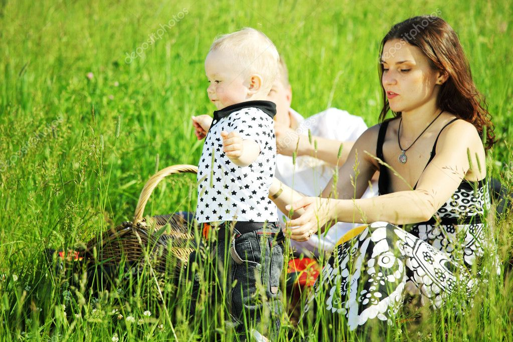  happy family on picnic in green grass  Stock Photo #6840687