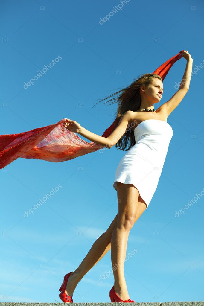 Summer woman in blue sky — Stockfoto #6849970