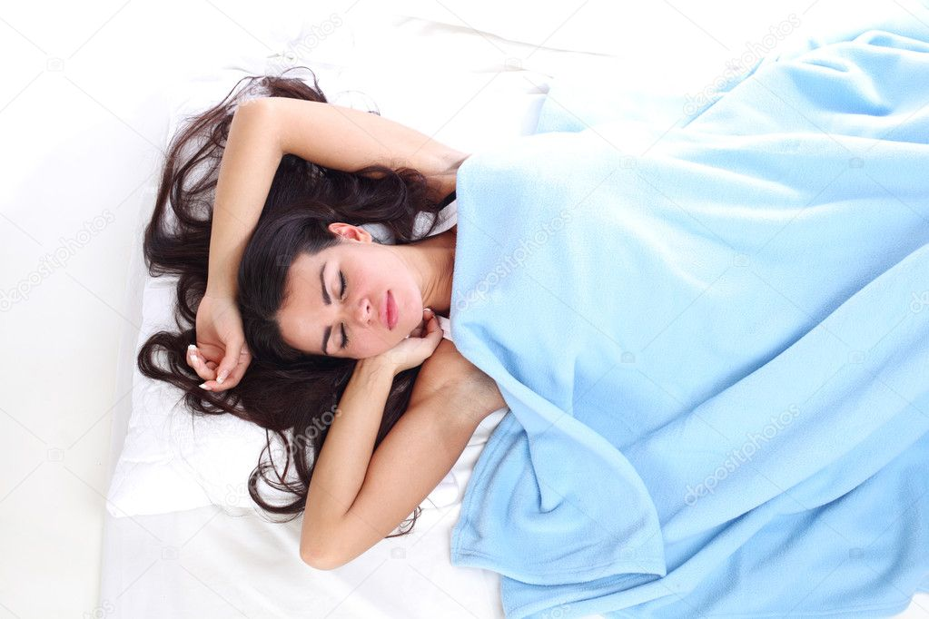 Waking woman on the white pillow — Stock Photo #6850077