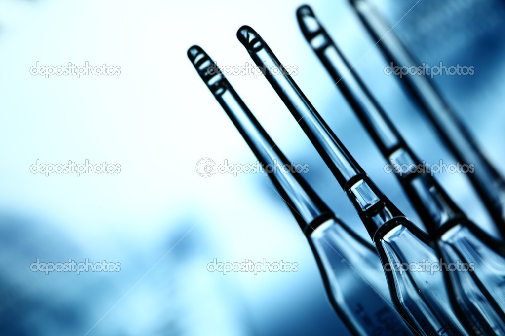 Ampoule on abstract bokeh background — Stock Photo #6881008