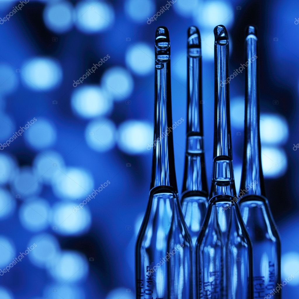 Ampoule on abstract bokeh background  Stock Photo #6881011