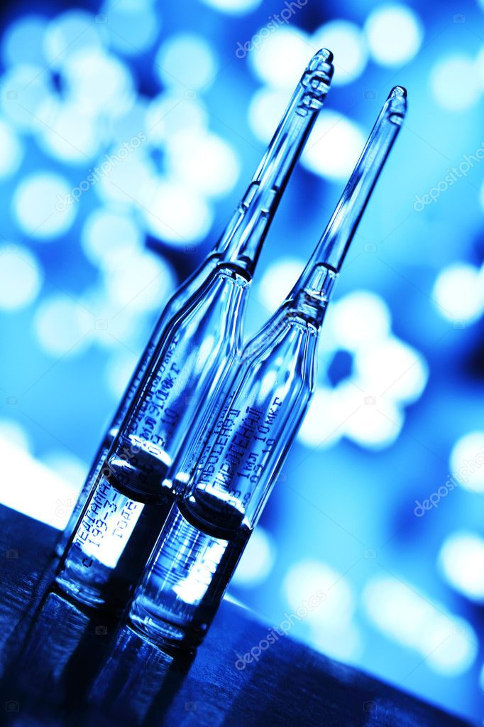 Ampoule on abstract bokeh background  Stock Photo #6881014
