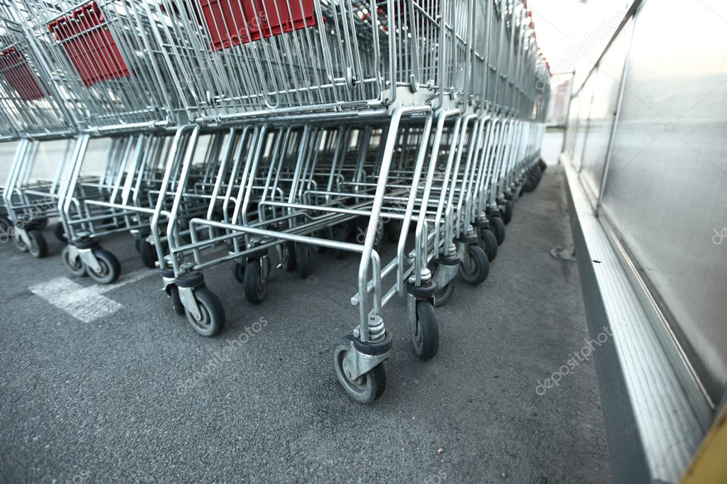 Shoping carts in a row close up — Stock Photo #6881431