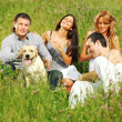 Friends and dog — Stock Photo
