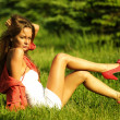 Woman on green grass — Stock fotografie #6892437