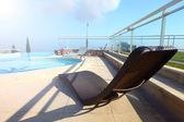 Lounge at pool — Stock Photo