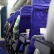 Airplane seats in row - Stock Photo