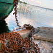 Boat on chain - Stock Photo