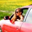 Woman in red car — Stock Photo