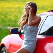Woman in red car — Stock Photo #6933462