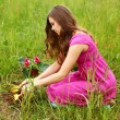 Girl grow flower — Stock Photo #6933857