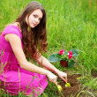 Girl grow flower — Stock Photo #6933861