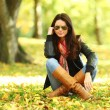 Woman portret in autumn leaf — Stock Photo #6934392