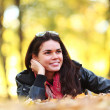 Woman portret in autumn leaf — Stock Photo #6934393