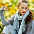 Woman portret in autumn leaf - Stock Photo