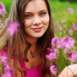 Woman on pink flower field — Stock Photo #6934693