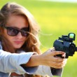 Woman with pistol - Stock Photo