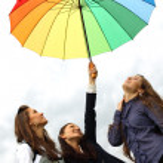 Girlfriends under umbrella — Stock Photo #6935072