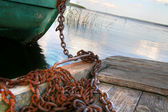 Boat on chain — Stock Photo