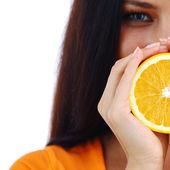 Orange in woman hands — Stock Photo