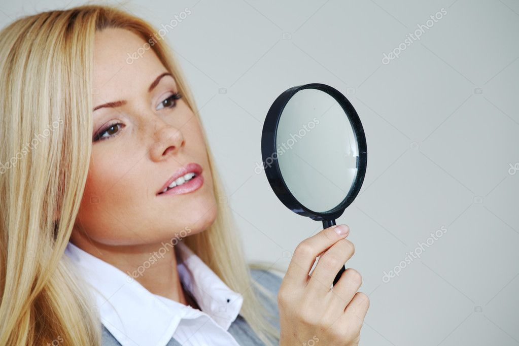 Business woman looking through a magnifying glass — Stock Photo #6933315