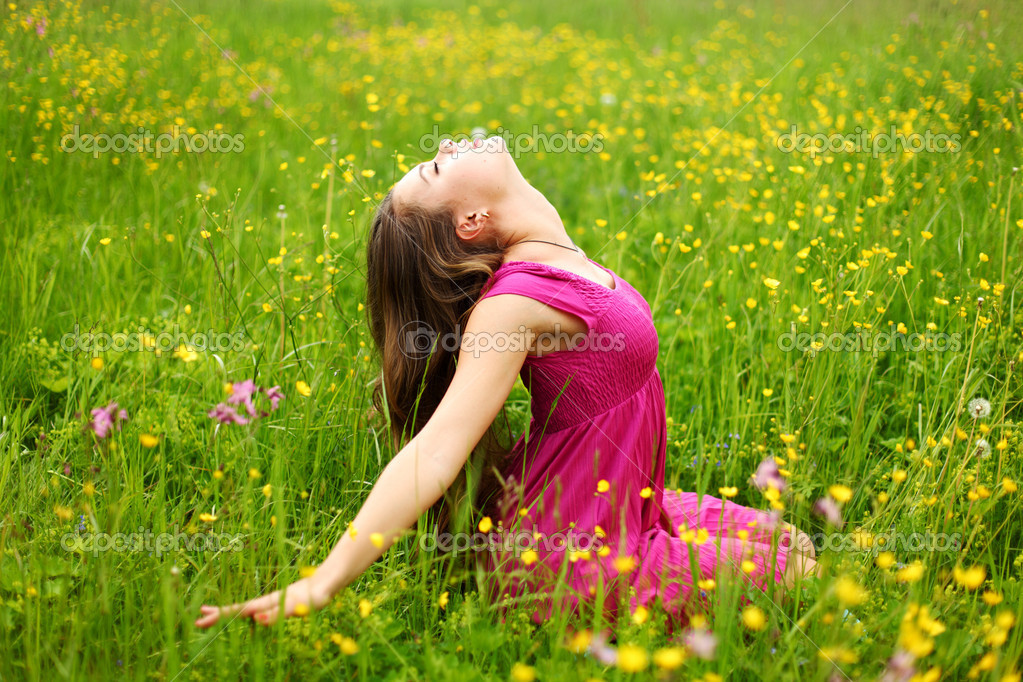 Woman on flower field close portrait — Stock Photo #6934788