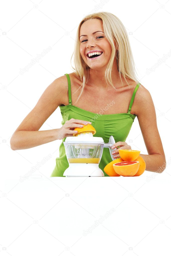 Woman squeezes juice by juicer — Stock Photo #6934951