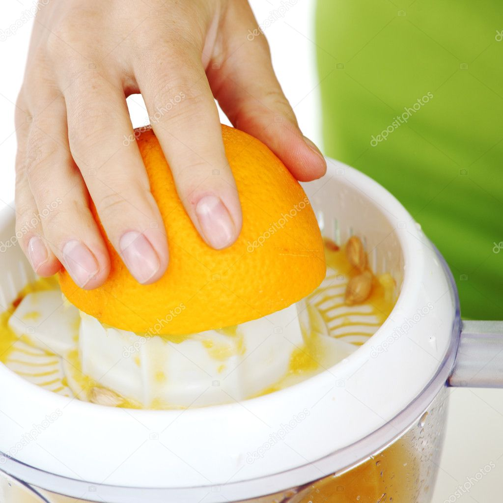 Woman squeezes juice by juicer — Stock Photo #6934953