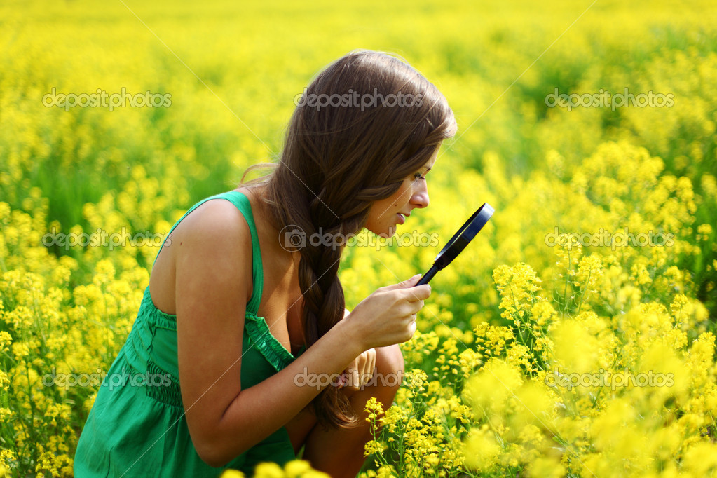 Botanist woman in yellow flower field — Stock Photo #6935192