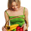 Woman holds a basket of fruit — Stock Photo