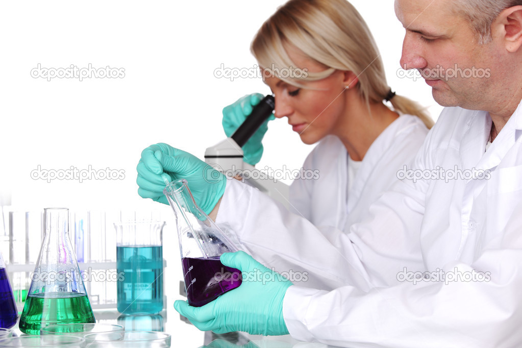 Two scientist in chemical lab conducting experiments — Stock Photo #6978866