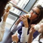 Happy women licking ice cream — Stock Photo #7077681