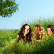 Girlfriends under tree — Stock Photo