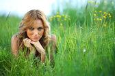 Blonde on grass — Stock Photo